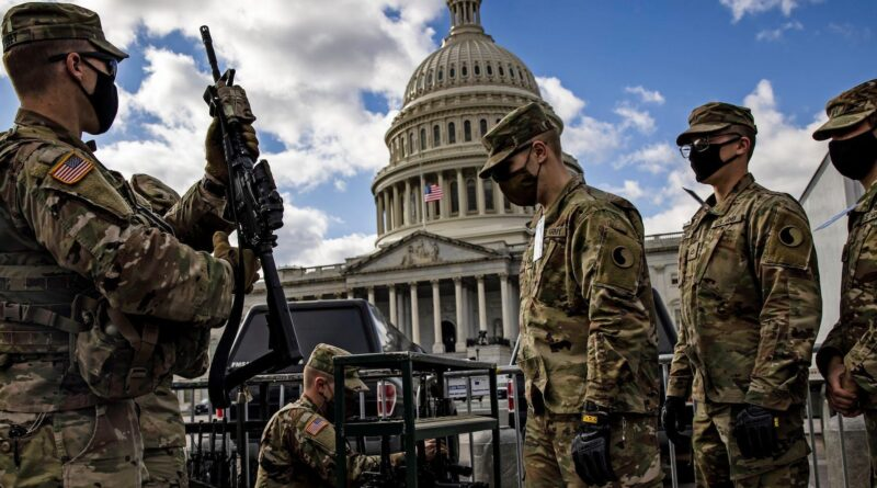 12 National Guard troops were pulled off security for Biden's inauguration over concerns including suspected ties to far-right groups