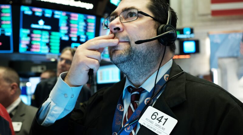 Dow futures drop 100 points amid climb in interest rates